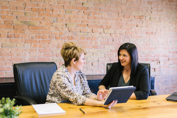 manager and employee discussing probation period at a desk in an office